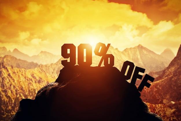 90% off writing on a mountain peak.