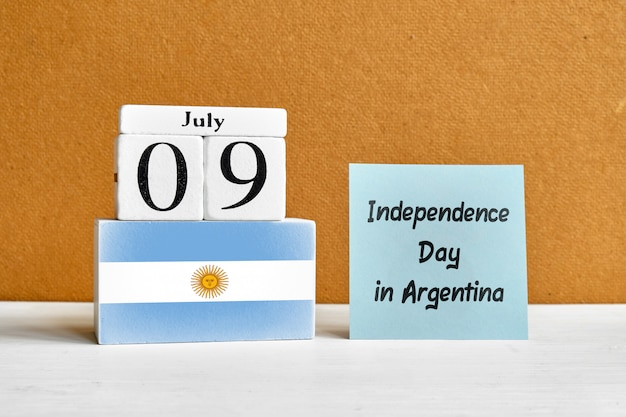 9th july independence day in argentina ninth of month calendar concept on wooden blocks.