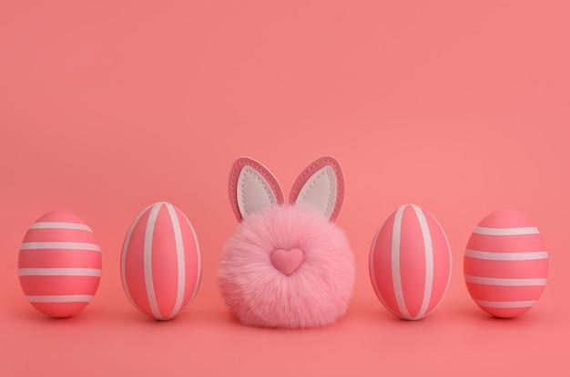 Монохромная пасха. розовый пушистый кролик помпон между розовыми полосатыми яйцами. изолированные на розовом фоне. розовые полосатые яйца в ряд. пасхальная открытка, дизайн, баннер. копировать пространство