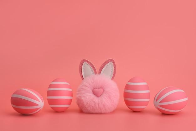 Смешной пасхальный розовый кролик помпон между розовыми полосатыми яйцами. белые полосы на розовые яйца. розовый фон монохромный пасхальная концепция. пасхальная открытка, дизайн, баннер. скопируйте место, место для текста.