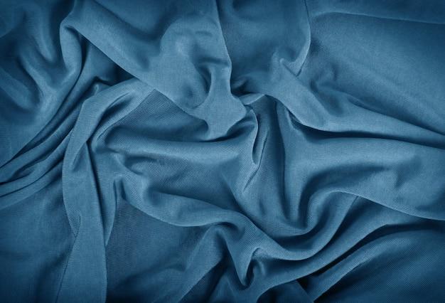 青いカールした布の背景