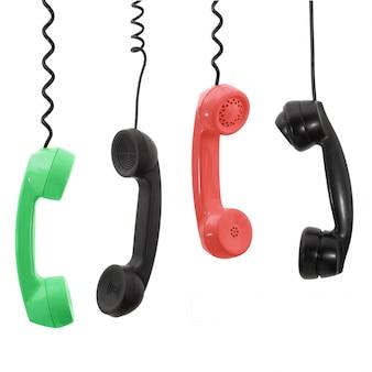 白い背景の上の電話の受話器