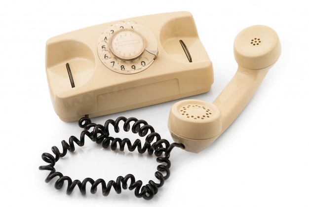 白い背景の上の古い電話