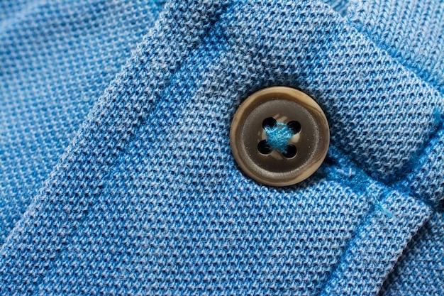 ブルーのポロシャツの質感、コットン生地。繊維の背景
