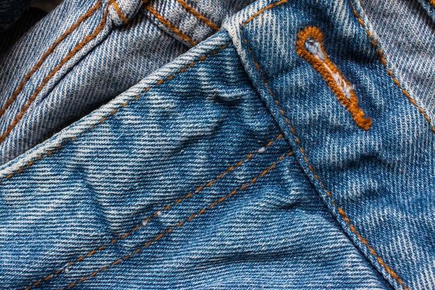 デニムジーンズの質感、コットン生地。ポケットとリベット。