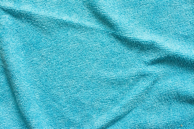 青いマイクロファイバーの布、マクロ繊維パターン背景の表面