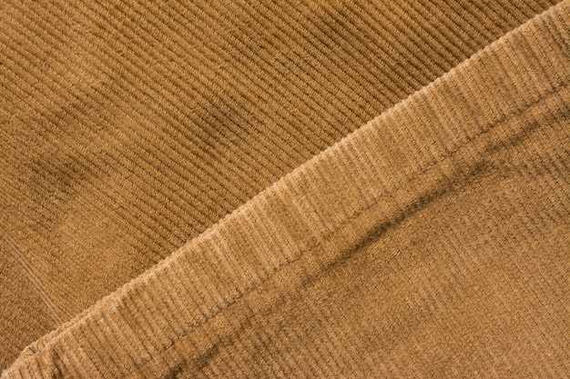 Бархатная текстура брюк, хлопчатобумажная ткань. карман и заклепка. текстильный фон