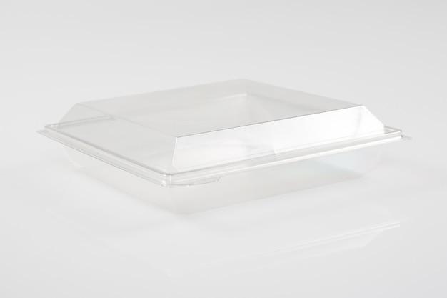 白い空の空の発泡スチロールのふたが付いているプラスチック食糧皿の容器箱