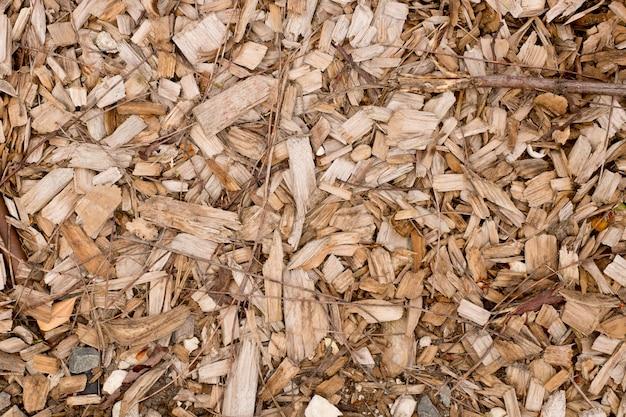 茶色と黄褐色の木材チップの背景
