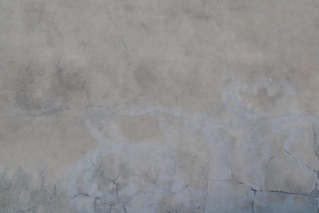 Грязная и старая цементно-серая бетонная стена