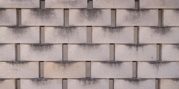 コンクリートタイルコンクリートブロック壁クラッディングテクスチャ灰色の背景