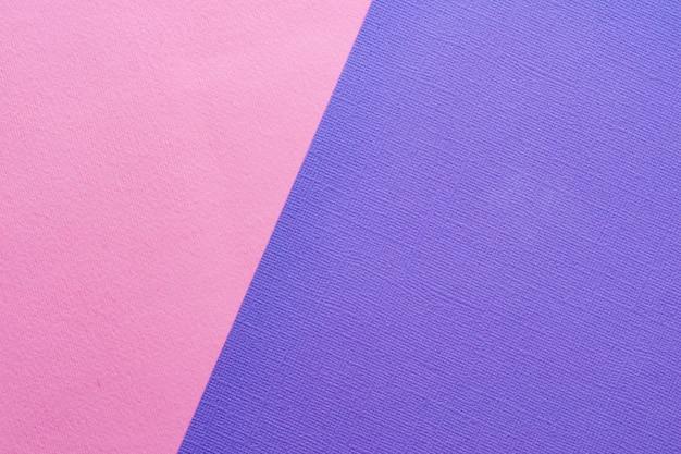 背景色の紙のシート。青、ピンク。