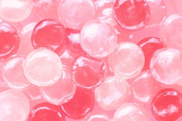 ピンクのお菓子の背景のトップビュー