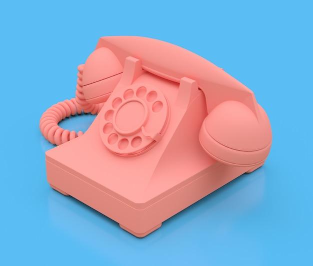 青い表面に古いピンクのダイヤル電話