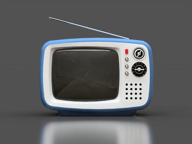 Милый старый синий телевизор с антенной на серой поверхности