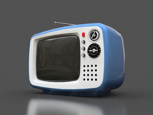 灰色の表面にアンテナを持つかわいい古い青いテレビ