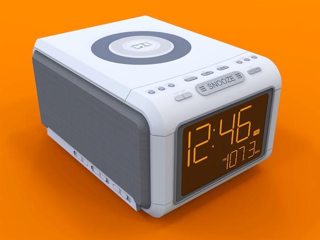 オレンジ色のラジオ付き時計 - 目覚まし時計