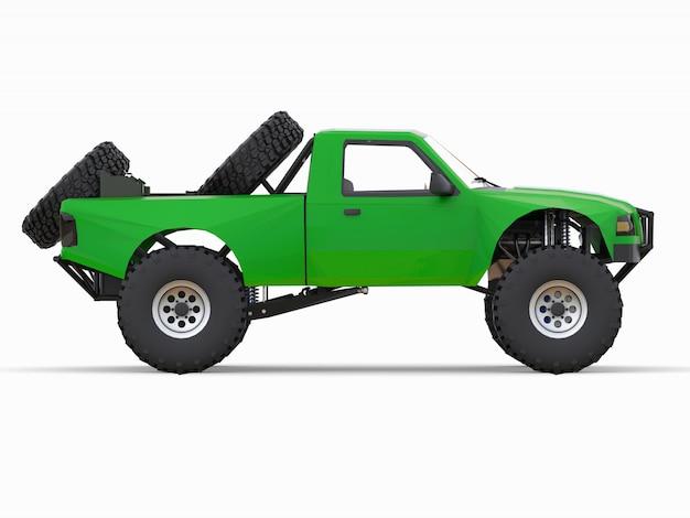 Зеленый спортивный гоночный грузовик для пустынной местности