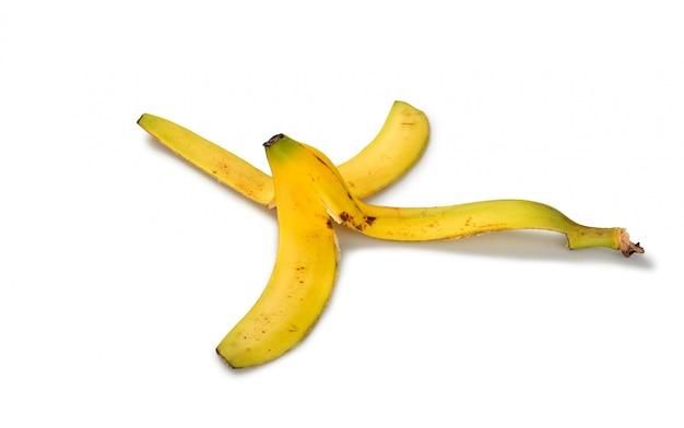 白い背景の上の肌のバナナ