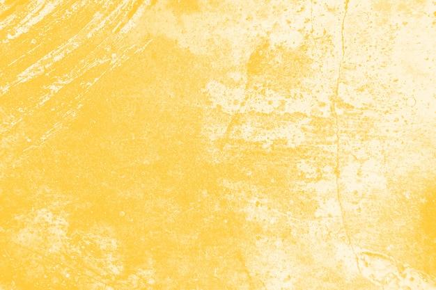 黄色の苦しめられた壁のテクスチャ背景