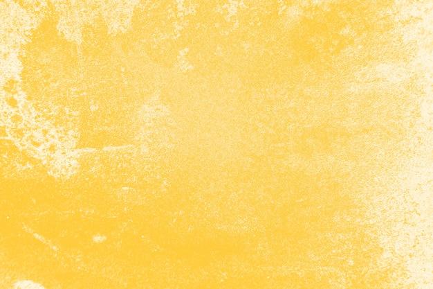 苦しめられた黄色の壁のテクスチャ背景