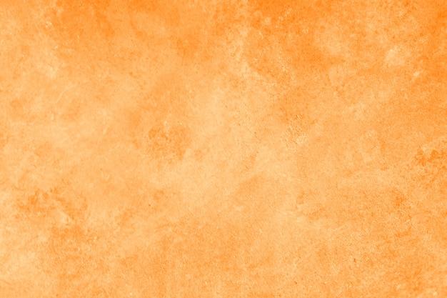 抽象的な明るいオレンジ色または黄色の壁のテクスチャ