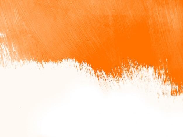オレンジ色の水彩ブラシストロークの背景