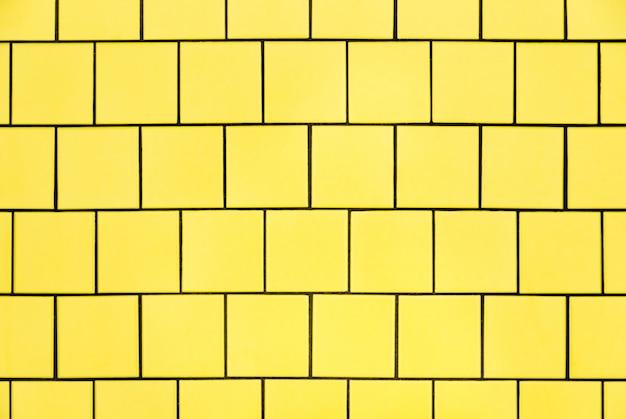 黄色のタイル壁の背景