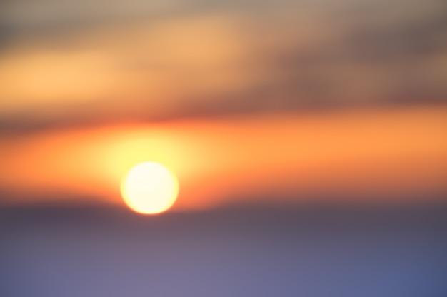 海で夕日の多重背景をぼかし