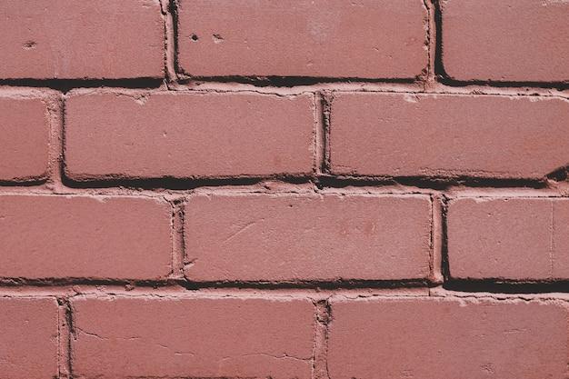 Красная предпосылка текстуры кирпичной стены.