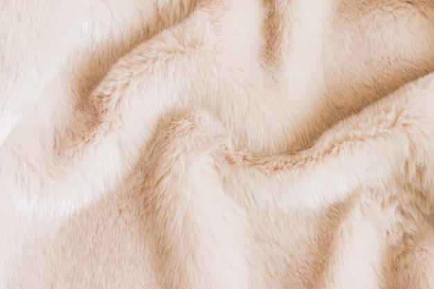 ベージュのシャギー毛皮の質感。動物の質感