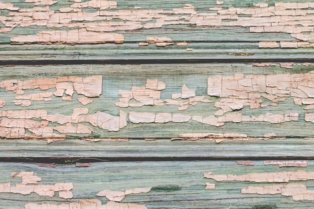古い木製のアクアマリンの壁の背景を描いた。