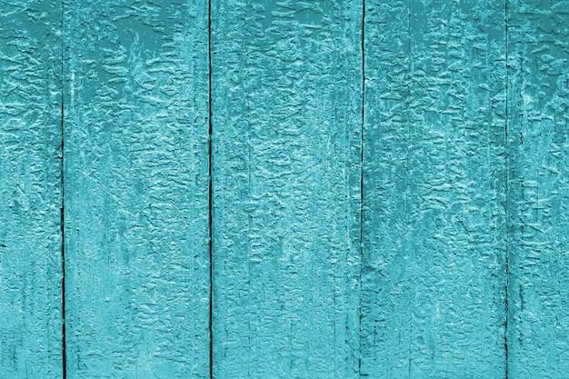 青い塗られた古い木製アクアマリンの壁の背景。