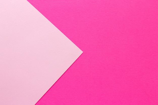 淡いピンクと濃いピンクのパステル紙の背景デザイン。