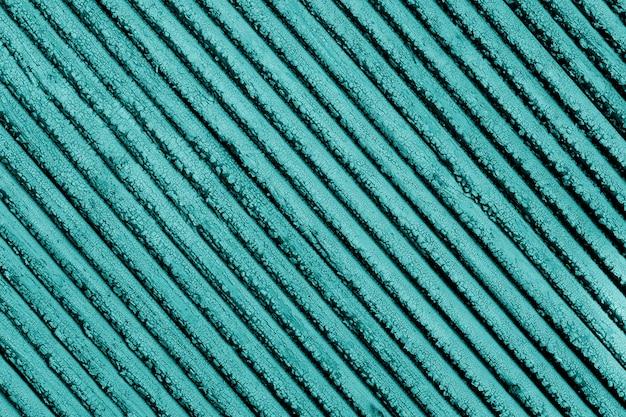 木の板にひびの入った青い絵の具の古いビンテージテクスチャ。古い青いペンキテクスチャクローズアップ