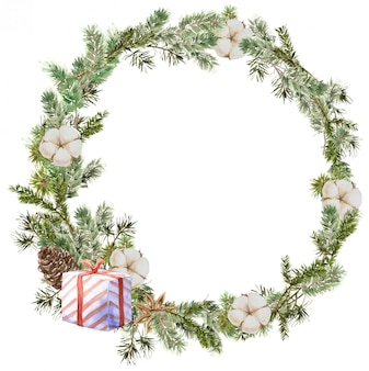 Композиция венок с рождеством с сосновыми и еловыми ветками, хлопком, цветком аниса, подарком и шишкой. зимняя круглая рамка