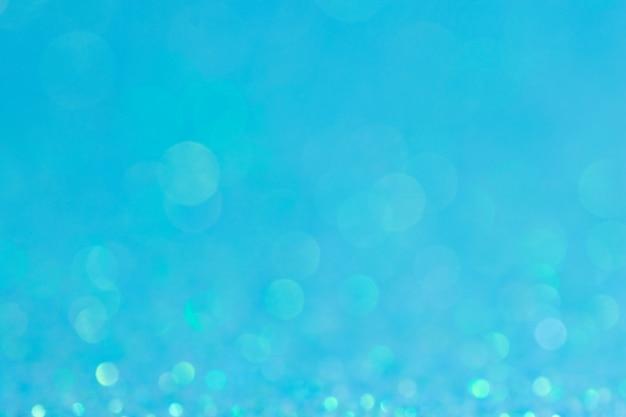 抽象的なボケサークルブルーの背景