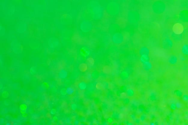 抽象的なボケサークルグリーンの背景色