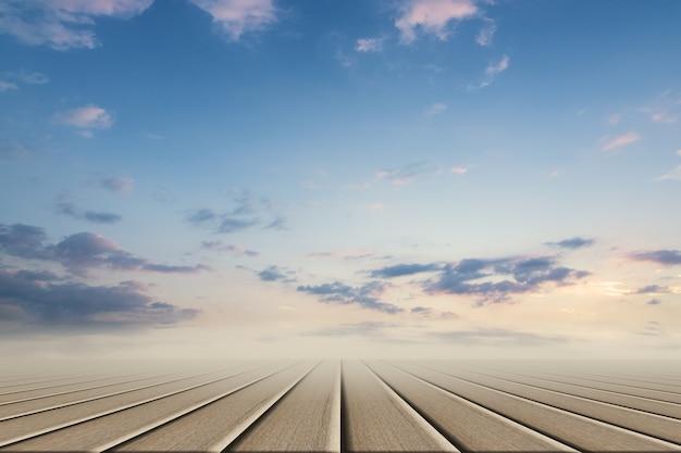 木製の床と昼間の空の背景