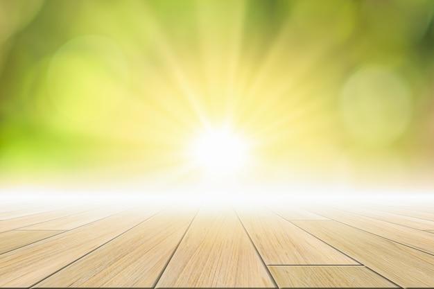 木の床のシーンの背景太陽の光と緑のボケ