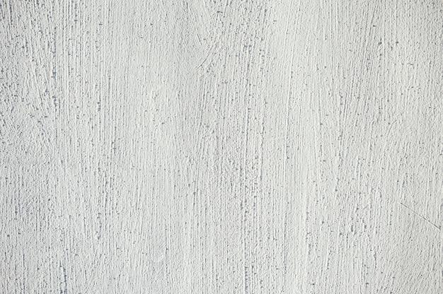 塗られた壁の白のエンボス加工の質感。パターン。