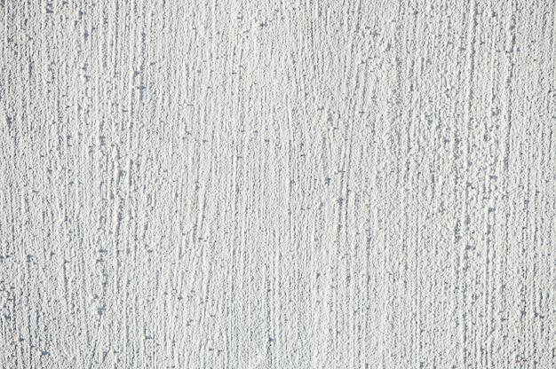 塗られた壁の白いエンボス加工のテクスチャ