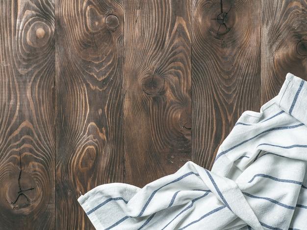 木製のテーブル、平面図、モックアップのリネンナプキン