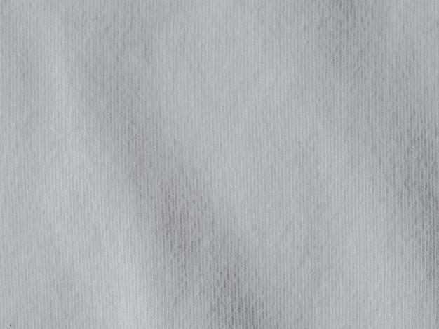 白い綿生地のテクスチャ。ひだに服コットンジャージー背景