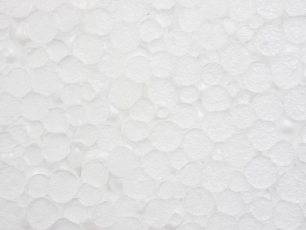 背景として白いプラスチック泡テクスチャをクローズアップ