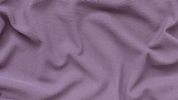 表面の波と紫のリブコーデュロイテクスチャ背景。バナー
