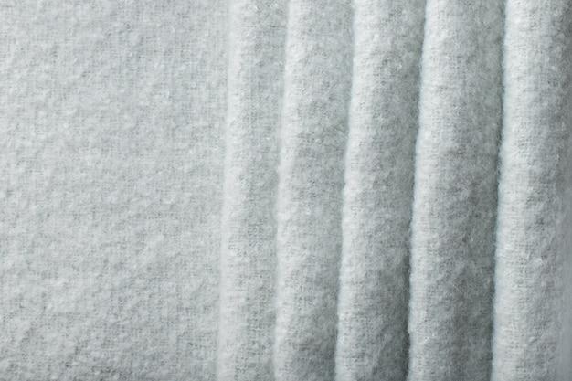 水色の柔らかい布の背景。表面の折れ線。スパの背景。セレクティブフォーカス