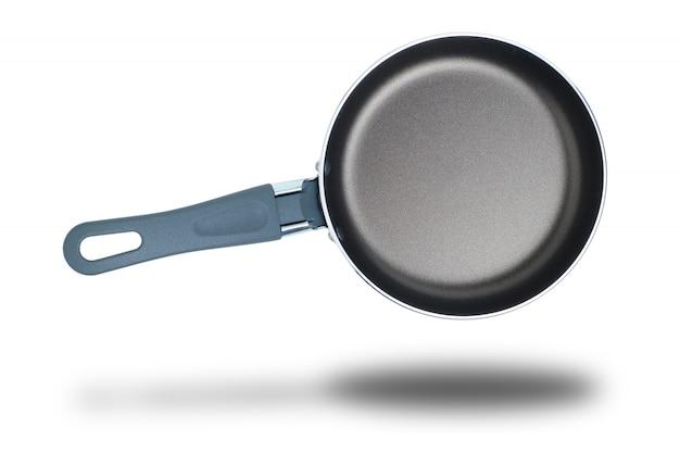 白い背景で調理するためのフライパン。分離されました。