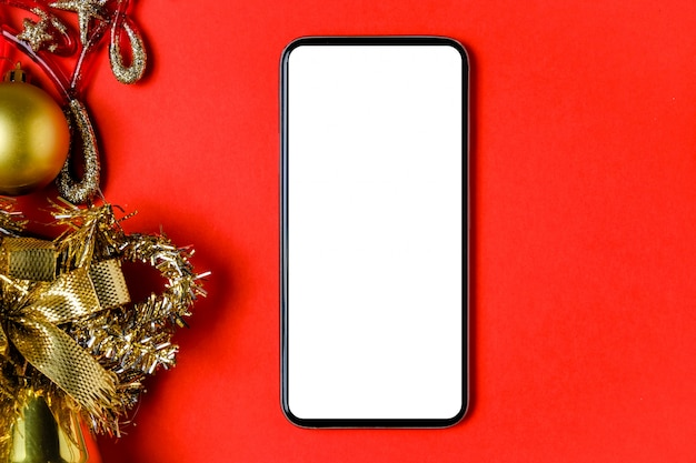 Макет смартфона, колокольчик, шар и мишура