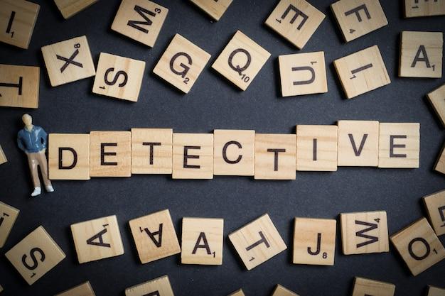 木製の手紙-探偵、抽象的な男性モデルと黒で作られた単語。調査専門職。